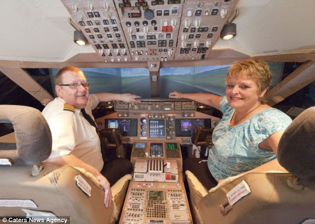 Inside the cockpit: Luckily, Miss Mabey (right) does not have a problem with the lack of space in the bedroom