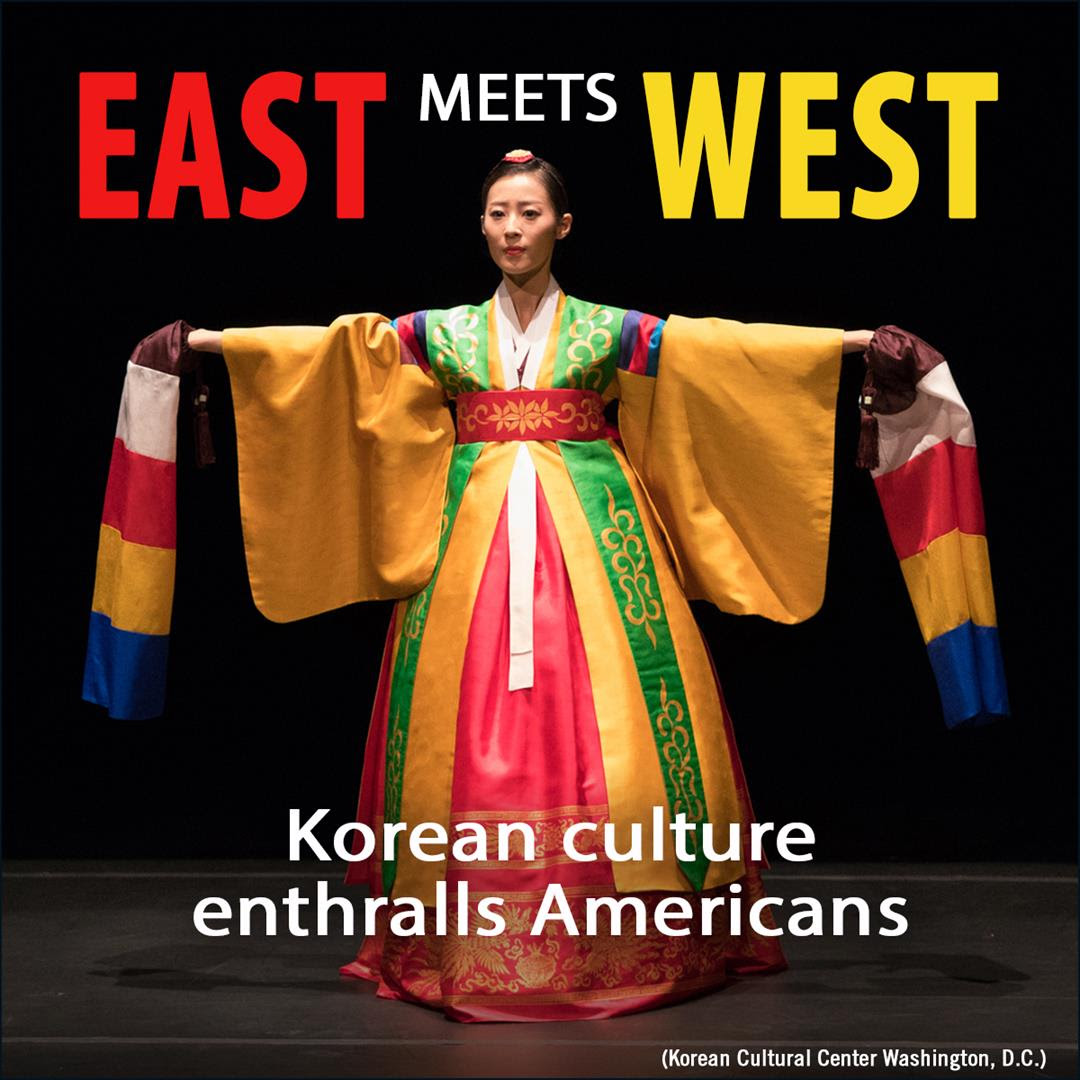 """Woman in traditional Korean wardrobe with caption """"East meets West"""". (State Dept. / D. Thompson)"""