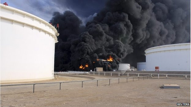 Smoke rises from an oil tank fire in Es Sider port December 26, 2014