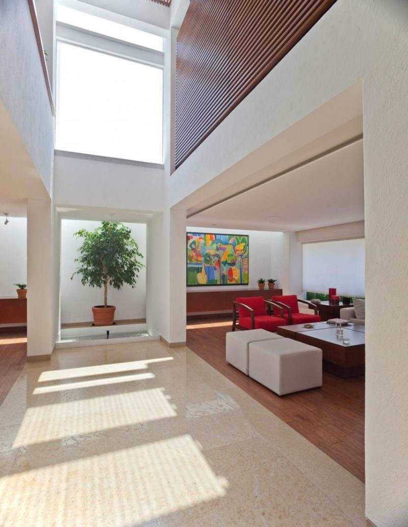 living room with high ceiling and skylight