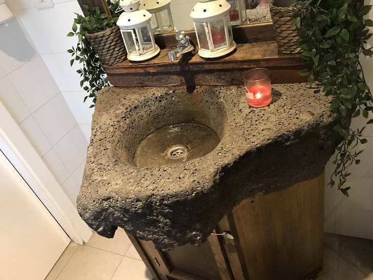 9 - This bathroom sink is made of igneous rock from volcanic lava.