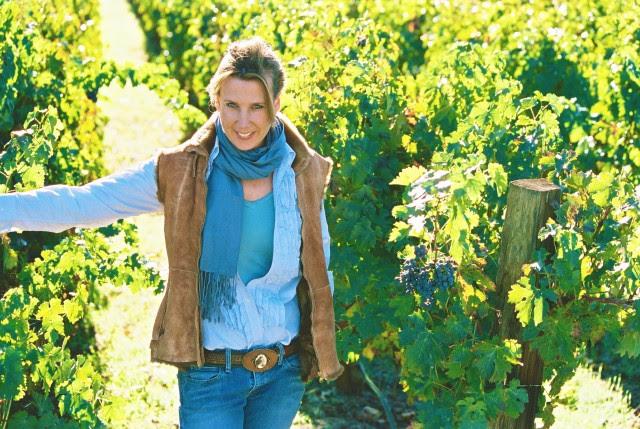 Gina standing in vineyard