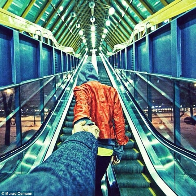 Love on an escalator: There are also more down-to-earth shots like as Murad documents every element of their adventures