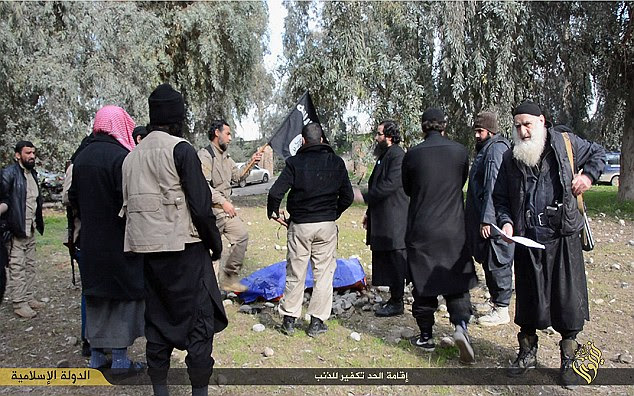 A horde of Islamic State militants are shown hurling large rocks at the woman before her body is covered by an old piece of blue tarpaulin