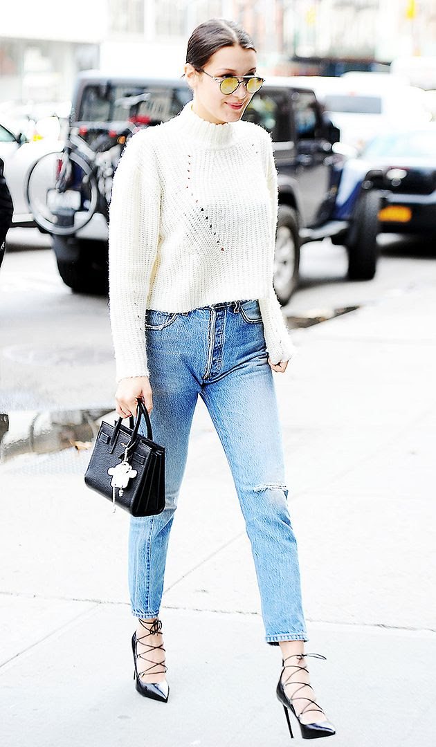 Le Fashion Blog Model Bella Hadid Style Mirrored Sunglasses White Sweater Vintage Levis Jeans Black Lace Up Pumps Via Who What Wear