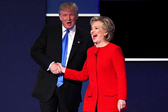 Democratic presidential candidate Hillary Clinton shakes hands with Republican presidential candidate Donald Trump on stage at the conclusion of the first presidential debate at Hofstra University.