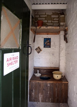 Nature calls: The original lavatory is in an old outhouse in the garden, and if you have an air raid shelter you've just got to have a gasmask ready for use - Ben keeps it in the hallway