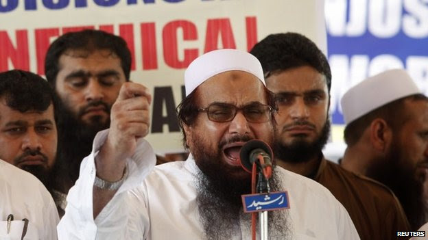 Hafiz Saeed (centre) addresses his supporters in Lahore. Photo: 27 June 2014