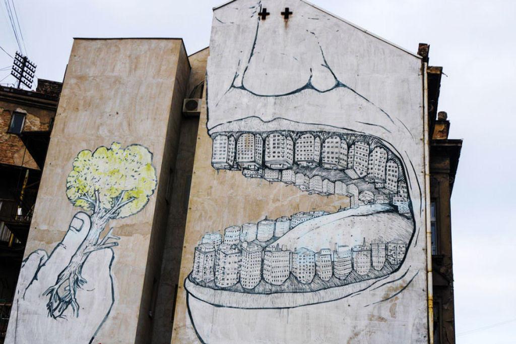 24 eloquentes obras de arte urbana mostrando a desagradável verdade 03