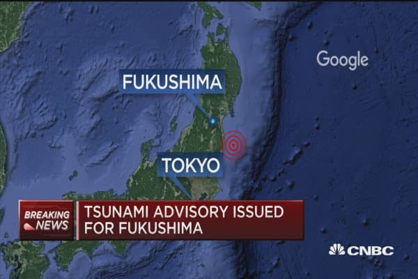 Japan earthquake downgraded to 6.9 from 7.3