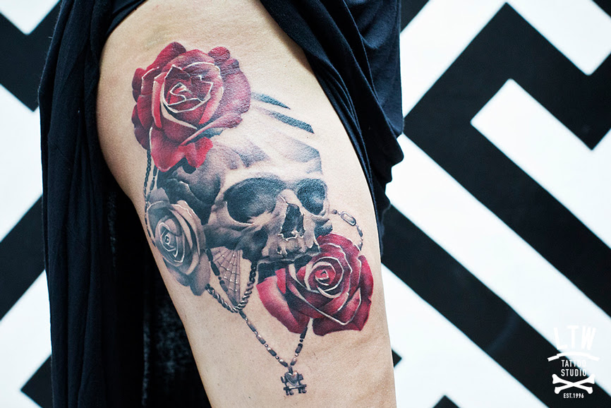 Grey Ink Skull And Rose Tattoos