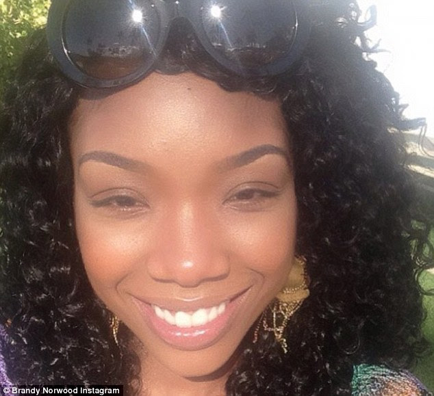 Fresh-faced: The star posts a picture of her flawless complexion while she's sunning herself