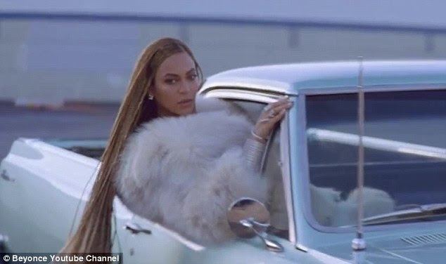 Fancy: She could also be seen hanging out of the passenger side of a classic car while wearing a fur coat