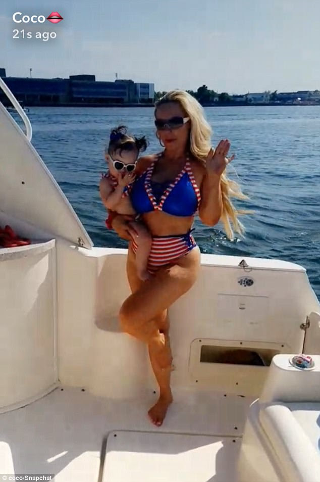 Twinning:Seemingly a fan of matching outfits, Coco dressed her daughter in a similar red and white striped bathing suit