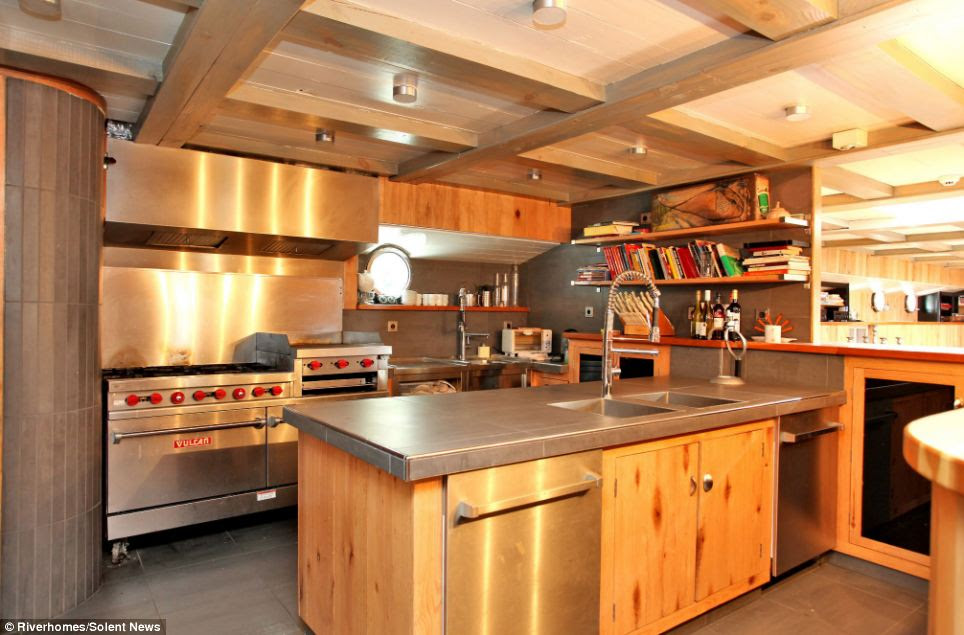 Houseboat: Le Sorelle also boasts two kitchens which also feature Spanish tiles