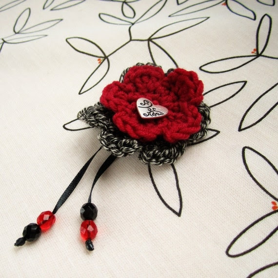 Crocheted flower hair clip with heart center and cascading beads