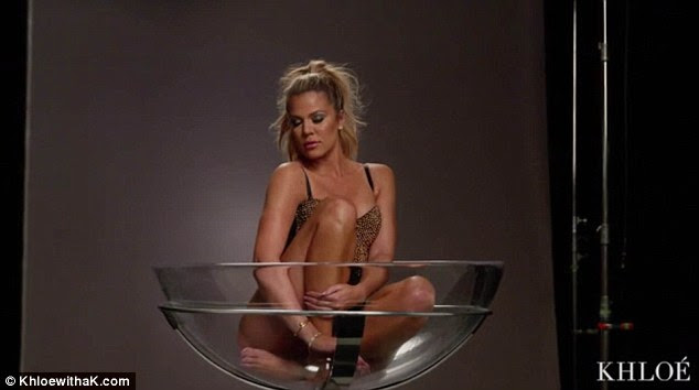 Posing: The reality star climbed into a giant martini glass