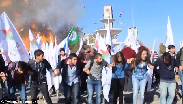 Terrifying: Peaceful demonstrators at a pro-Kurdish rally on October 10, 2015 react as a powerful blast goes off behind them. An explosion in Ankara today has killed at least 18 people and left 45 others injured