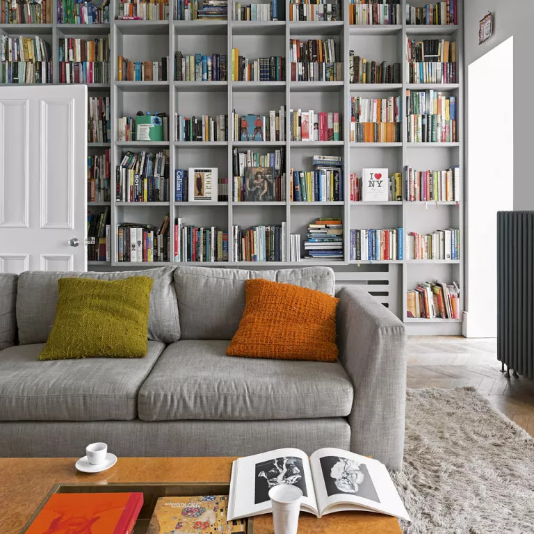 Grey living room with floor to ceiling built in bookcase