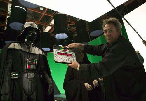 Producer Rick McCallum poses with the slate as Darth Vader (Hayden Christensen) and Emperor Palpatine (Ian McDiarmid) look on.