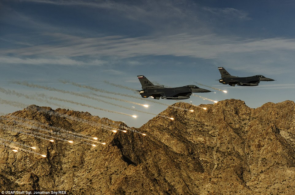 Flares: Two F-16C Fighting Falcons release flares while conducting low-level combat training during the Coronet Cactus exercise near Davis-Monthan Air Force Base, Arizona The F-16s are assigned to the 182nd Fighter Squadron. This exercise provides realistic combat training for student fighter pilots