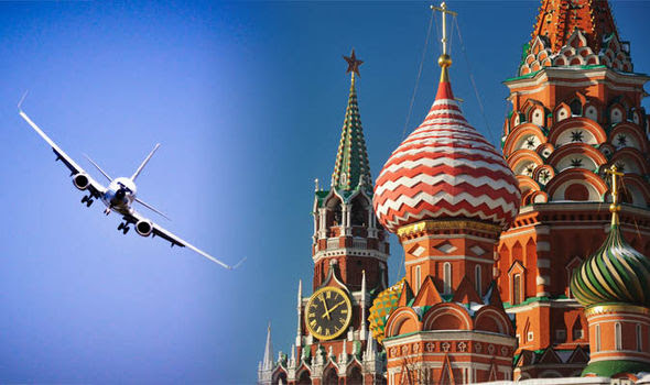 An airplane flying over the Kremlin