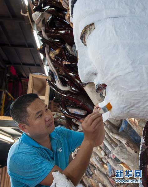 Masks are applied to the face of the statue to reinforce its structural integrity and pave the way for future repairs.