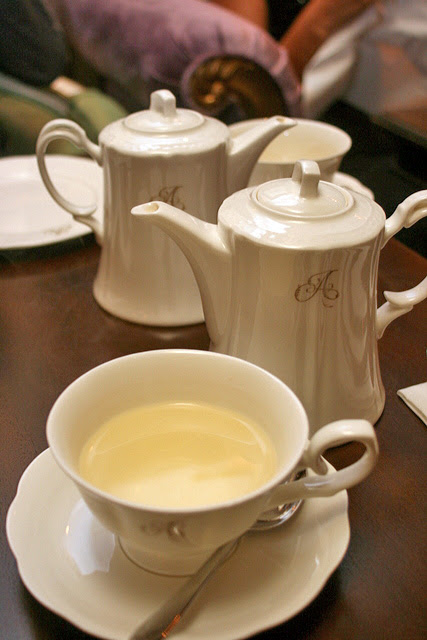 "Teas served in elegant pots with the initial ""A"""