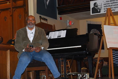Abayomi Azikiwe, editor of the Pan-African News Wire, at Central United Methodist Church chairing MLK Day on Jan. 21, 2013. The annual event attracts activists from throughout the region. (Photo: Sharon Black) by Pan-African News Wire File Photos