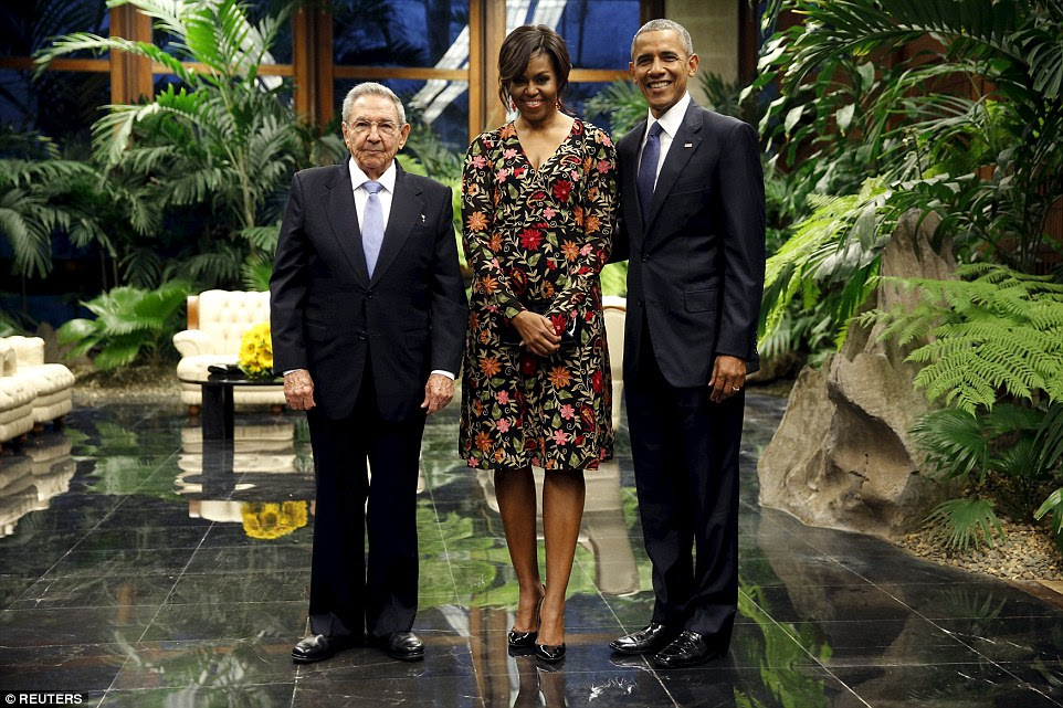 First Lady Michelle wore an eye-watering pair of patent black stilettos with her Naee Khan floral dress and bright red earrings, while President Barack Obama and President Raul Castro opted for simple dark suits, white shirts and ties in different shades of blue
