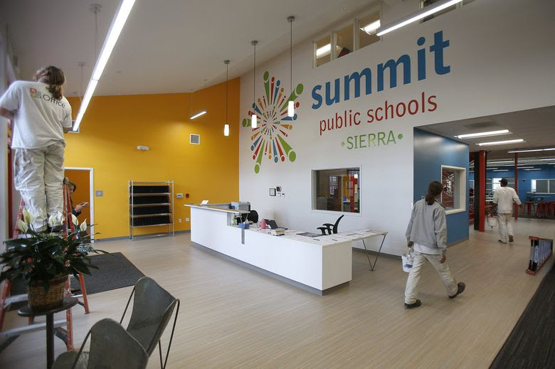 Employees of Washington Commercial Painters retouch the interior at the Summit Sierra charter school in Seattle after hours Friday. (Sy Bean / The Seattle Times)