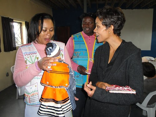 Vuyo's lovely handmade Xhosa doll goes to a graceful and stunningly lovely Halle Berry