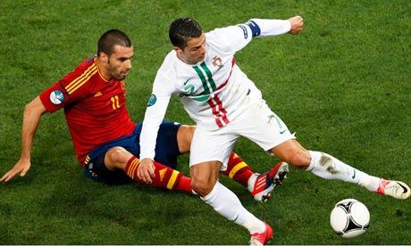 Portugal's Cristiano Ronaldo in action against Spain's Alvaro Negredo, Euro 2012 semi-final, Donetsk