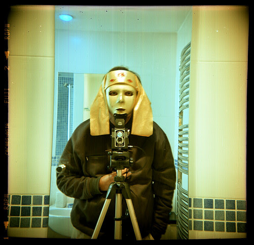 reflected self-portrait with Ross Ensign Ful-Vue camera and Egyptian headress by pho-Tony