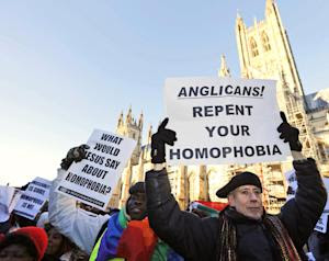 Human rights campaigner Peter Tatchell, right, demonstrates …