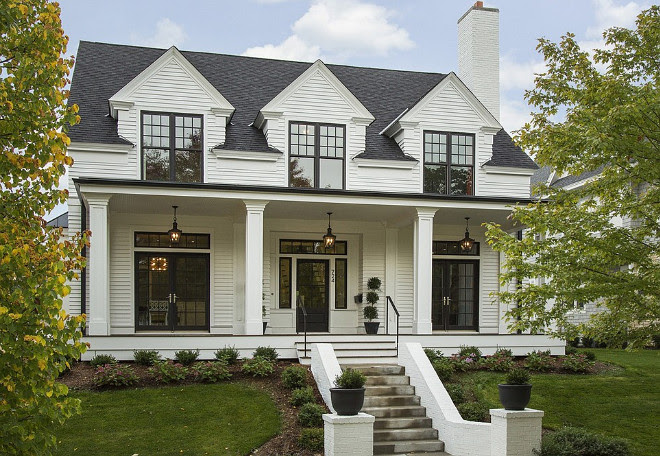 "White house with black accents, gutters painted in black to match the black windows. White siding is Hardie Artisan 4"" lap siding - with the Artisan siding you can mitre the outside corners. #Whitehouse #Whitehome #Whitehomepaintcolor #whitehouseblackwindows Spacecrafting Photography. Charlie & Co. Design, Ltd. Kroiss Development, Inc."