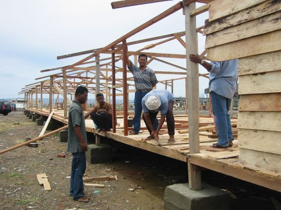 Building barracks in Aceh as temporary accommodation to house homeless tsunami victims. Photo: Bill Nicol
