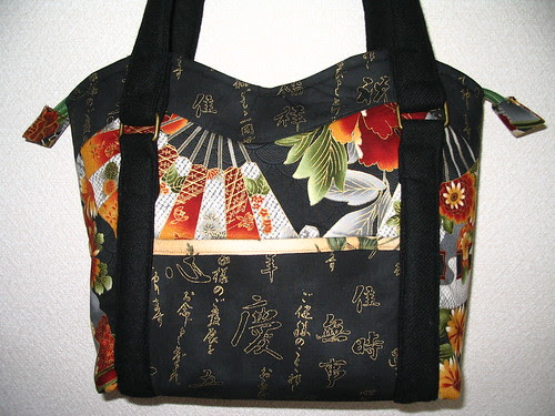 Front of small wavy top tote
