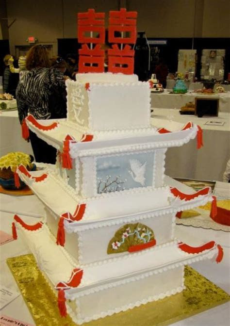 Four tier Chinese temple wedding cake with Chinse wedding