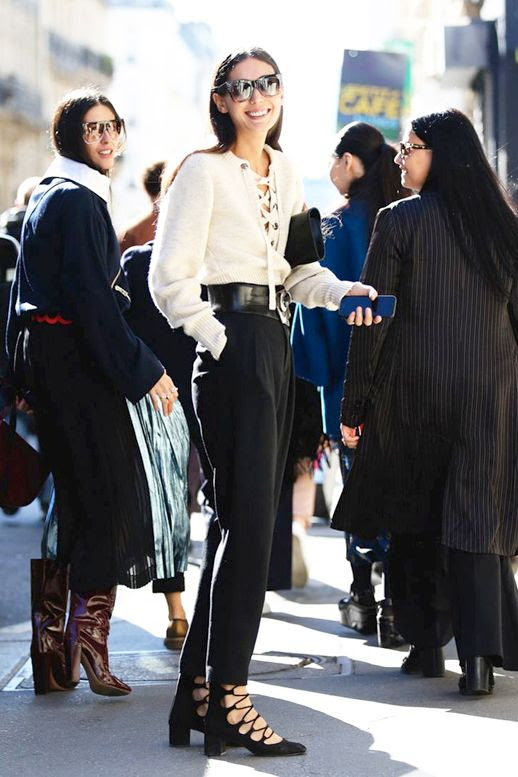 Le Fashion Blog Street Style Oversized Sunglasses Lace Up Details White Sweater High Waisted Belted Pants Short Black Heels Via Refinery29