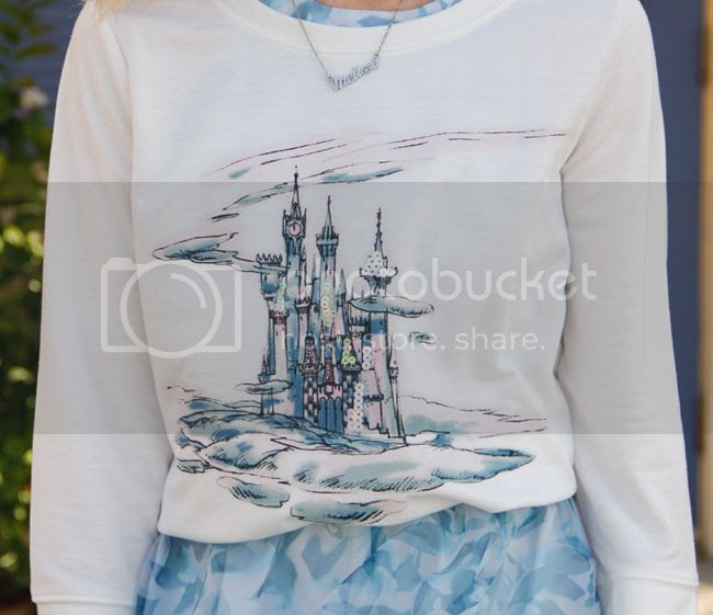 Fashion blogger The Key To Chic wears a LC Lauren Conrad for Kohl's Disney Cinderella collection castle graphic sweatshirt and organza bow back dress.