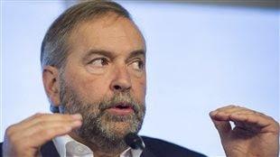 «On demande à M. Harper de trouver les moyens d'agir», dit le chef néo-démocrate, Thomas Mulcair, au sujet de la crise des migrants.