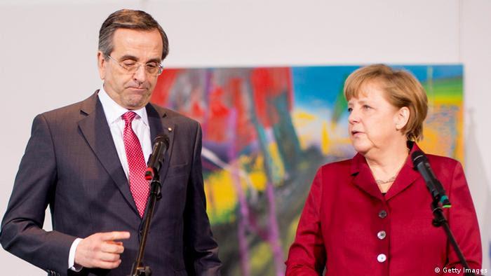 German Chancellor Angela Merkel and Greek Prime Minister Antonis Samaras (Photo by Carsten Koall/Getty Images)