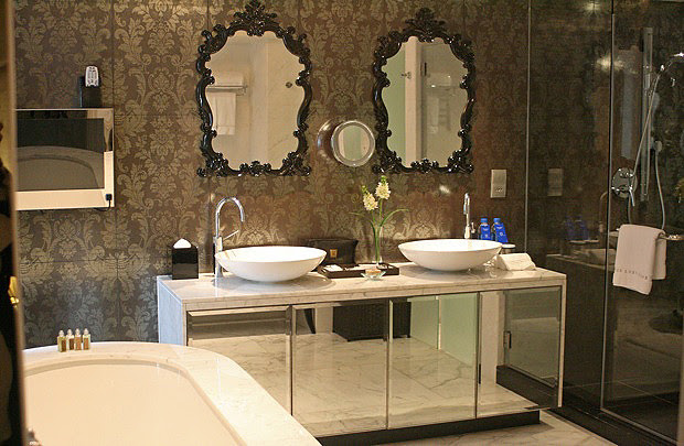 Twin basins, full bath and shower at the Royale suite