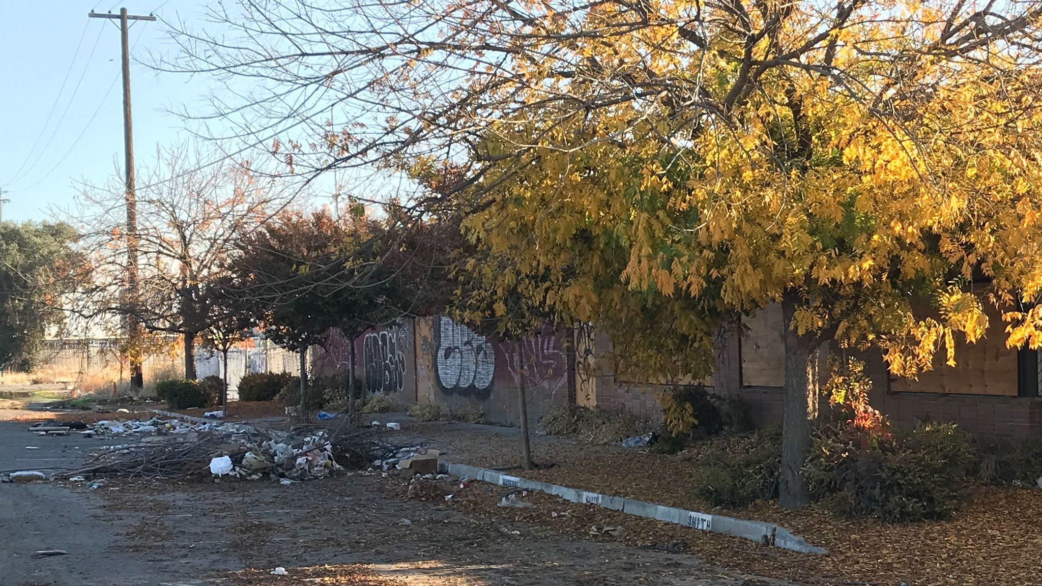 A rail property is strewn with trash in Fresno.