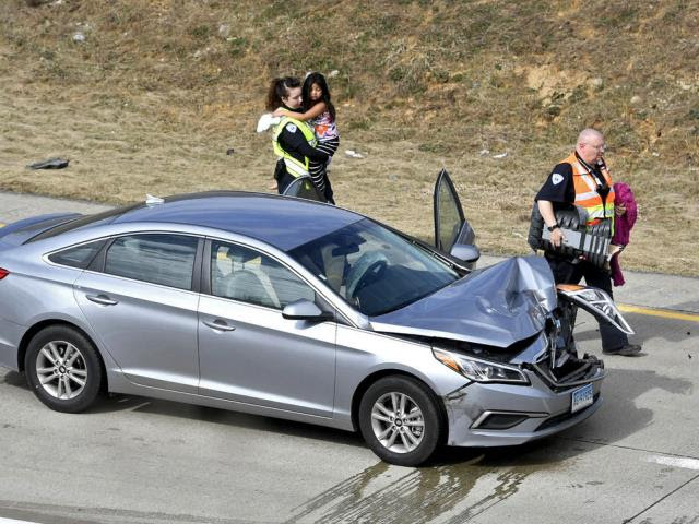 PA State Police troopers rescue Alyn Hernandez after her father crashed his car during a high-speed chase. (Photo: Abby Drey/Centre Daily Times via AP)