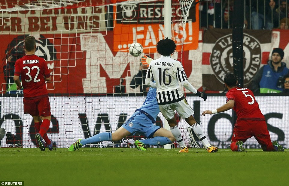 Cuadrado watches his effort curl past goalkeeper Manuel Neuer and into the corner of the net as Juventus took control with a 2-0 lead
