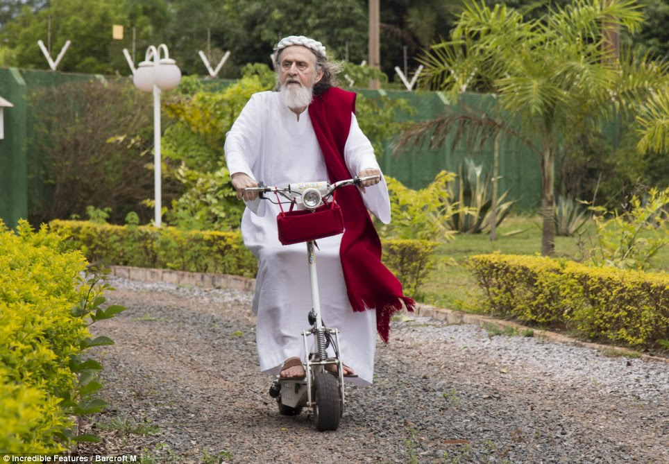 Biker Jesus: Inri Christo takes his scooter for a spin around his vast compound where he lives with his followers, preaching 'the word of Jesus'