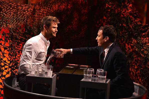 """Chris Hemsworth and Jimmy Fallon play a game of """"Water War"""" during a taping of """"The Tonight Show Starring Jimmy Fallon"""" at Rockefeller Center on January 13, 2015 in New York City."""