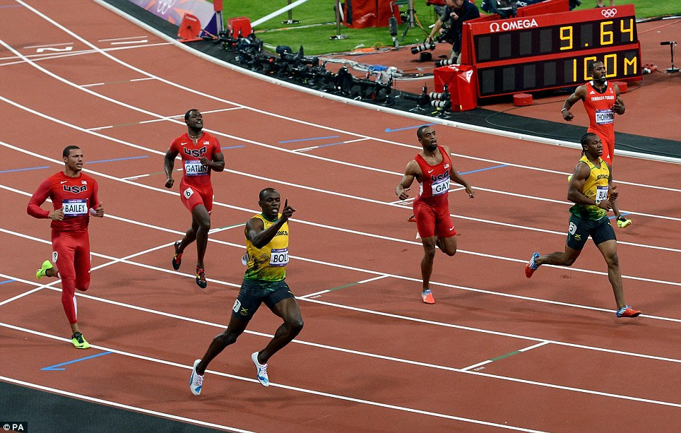 Number one: Usain Bolt raises a finger after clinching victory, with the time reading 9.64 seconds on the electronic board behind. The time was later officially rounded down to 9.63 seconds